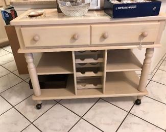 great looking buffet/cart with wine storage, shelf and drawers, has tile top