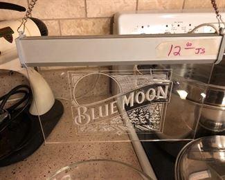 Blue Moon beer sign lights up