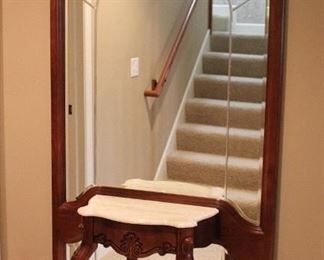 Wood framed arched mirror with marble top table