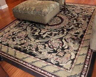 2 sizes: Classic rug in beautiful color palette of greens and berry colors along with cream and black background.