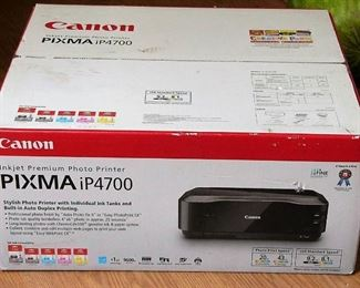 NEW IN BOX, CANON INKJET PREMIUM PHOTO PRINTER.  PIXMA iP4700.  GREAT FOR ALL THE HOLIDAY PICTURES YOU WILL BE TAKING!