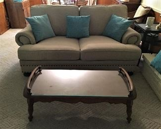 VERY NICE COMFY FULL SIZE SOFA AND WONDERFUL GLASS TOP COFFEE TABLE.  EASY TO COORDINATE WITH ANY COLOR SCEME.