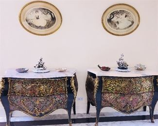 Sold as a pair or separately. ANDRE BOULLE: A PAIR OF ANDRE BOULLE COMMODES. 24K GOLD PLATING, BRONZE AND BRASSLOUIS XV STYLE MARBLE TOP 2- DRAWERBOMBE COMMODES/CHESTS:Here sitsan exact replica of a priceless piece from therenownAndre Boulle 1725-1814. The original residesin France'sVersaille Palace. This exquisite piecewas all hand crafted usingthe finest materials and master craftsmanship. Inlay of solid brass and solid bronze. 24K gold plating throughout. Never polish gold! The marble top is Carama, getting rare and truly beautiful as it ages. The patina exudesa warm glow and does not stain. A piece of Carama marble of this size and quality is significant. Andre Boulle isthe finest-functional French Furniture made because of the strong quality controls set by his estate. The valueonly increases in time.Height: 33.5 inches x Width: 45.5x Depth: 20.5 inches