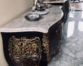 Sold as a pair or separately. ANDRE BOULLE: A PAIR OF ANDRE BOULLE COMMODES. 24K GOLD PLATING, BRONZE AND BRASSLOUIS XV MARBLE TOP 2- DRAWERBOMBE COMMODES/CHESTS:Here sitsan exact replica of a priceless piece from therenownAndre Boulle 1725-1814. The original residesin France'sVersaille Palace. This exquisite piecewas all hand crafted usingthe finest materials and master craftsmanship. Inlay of solid brass and solid bronze. 24K gold plating throughout. Never polish gold! The marble top is Carama, getting rare and truly beautiful as it ages. The patina exudesa warm glow and does not stain. A piece of Carama marble of this size and quality is significant. Andre Boulle isthe finest-functional French Furniture made because of the strong quality controls set by his estate. The valueonly increases in time.Height: 33.5 inches x Width: 45.5x Depth: 20.5 inches