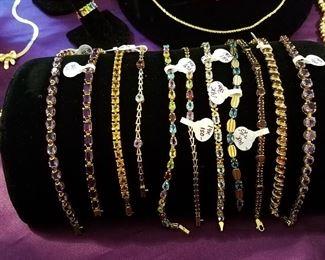 Gold bracelets with stones