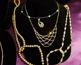 Gold necklaces.  Two gold necklace/bracelet sets