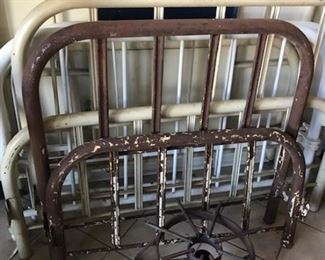 several antique iron beds