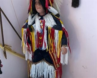 Porcelain Native American Indian doll with stand
