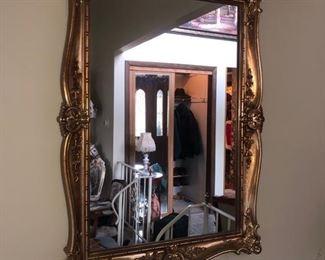 Gold framed wall mirror