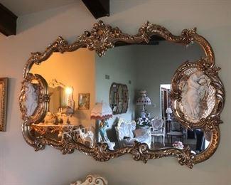 Large gold framed mirror.....