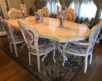 Matching dining room table with (8) chairs total.....