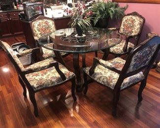 Glass topped table with 4 chairs.....