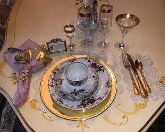 JB china set, gold flatware and gold trimmed crystal glasses