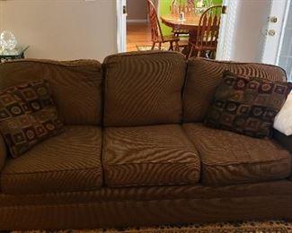 three cushion brown fabric sofa