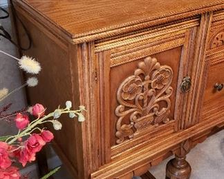 carving on oak dining buffet