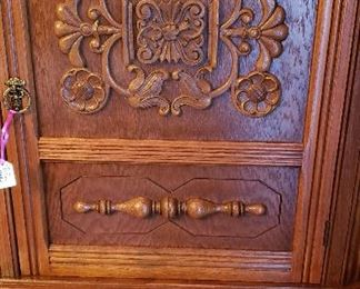 oak china cabinet with carving