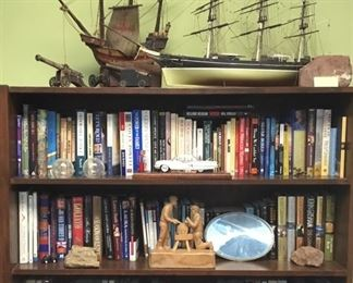 Military books, novels, cannon bookends.