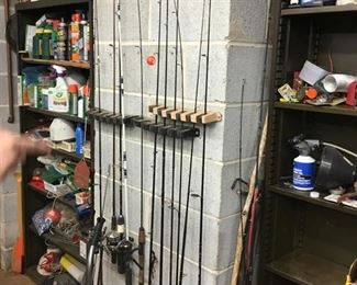Lots of fishing rods and reels.
