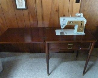 Singer sewing machine with attachments. (needs repair but overall is a good unit