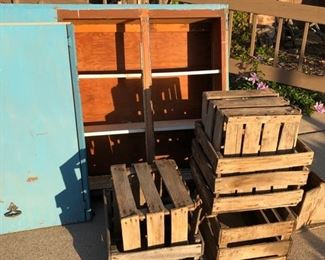 blue cabinet and apple crates