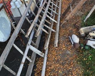 assortment of wooden ladders