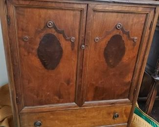Gentleman's chest of drawers with doors.
