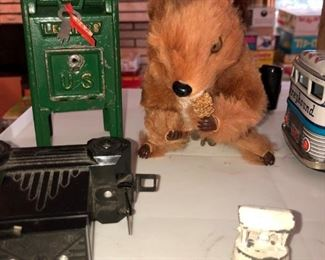 Cash iron mail box, toy camera, and jumping Squirrel