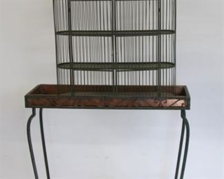 Antique Iron Planter Together With A Bird Cage