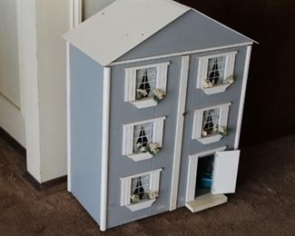 Fully furnished doll house with front opening.