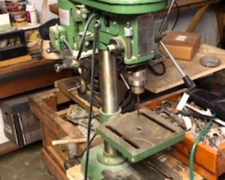 Drill press, and workshop with old tools.