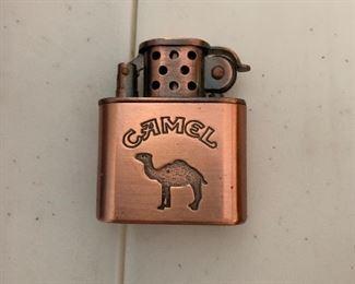Camel cigarette and Marlboro lighters