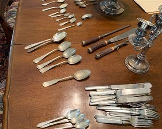 Assorted vintage spoons and silverware