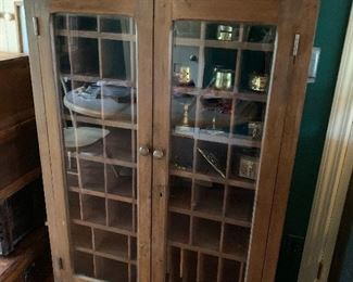 Cool display cabinet with lots of pigeon holes