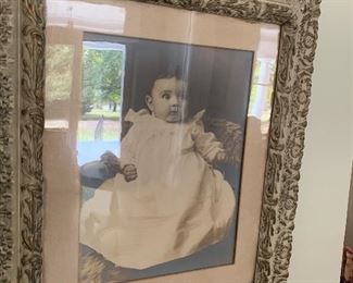 16x20 photo of baby in elaborate frame