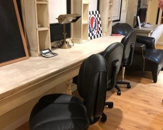 Three rolling office chairs