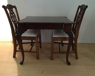 Wooden Game Table and Two Ornate Chairs