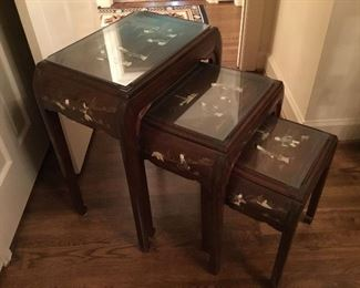 "Item #32 set of three Chinese Rosewood nesting tables with carved ivory, mother of pearls figures 28""h x 16 1/2""d x 22""w"