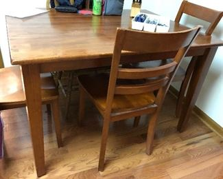 Wooden table with 4 chairs; nice size