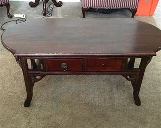 "Solid wood coffee table. Measures 20"" tall x 45"" long x 22"" wide. Has two small drawers on either side."