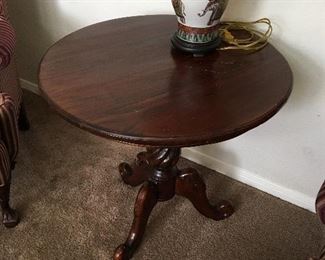 "Solid wood round end table. Most of the nicks and scratches are factory manufactured.  Measures 28"" tall x 28 1/2"" across."