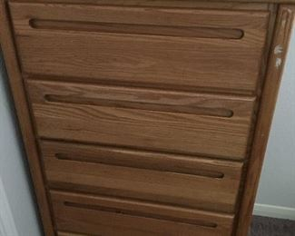 "Solid wood dresser chest All drawers slide well. Measures 40"" tall x 29"" wide x 16 1/2"" deep."
