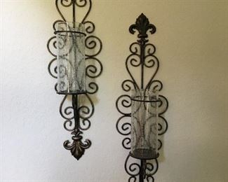 "Metal and glass candle holders. Measures 9"" tall by 8"" wide. Glass is 8 1/2"" tall.  Set of 2."