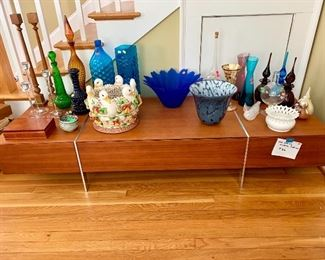 Modern Danish TV with hidden drawers various ceramics and vintage glassware.