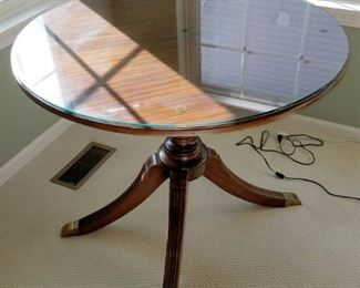 Footed round table with custom glass