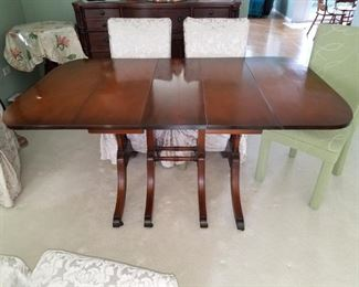 Duncan Phyfe dining room table and six parson chairs