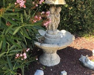 Cement Fountain.  Yard art potted plants