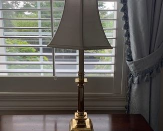 Table lamp, brass with cream shade.