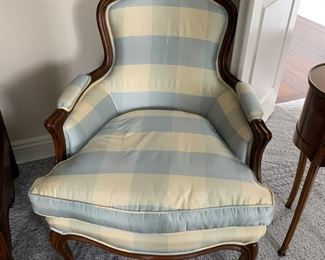 Pair Louis XV-style Bergere chairs, upholstered in blue and white striped taffeta fabric.