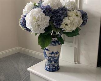 Blue & white decorative vase with silk flowers.