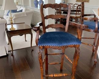 Set of three ladder back counter-height stools, upholstered in blue fabric with braided trim.